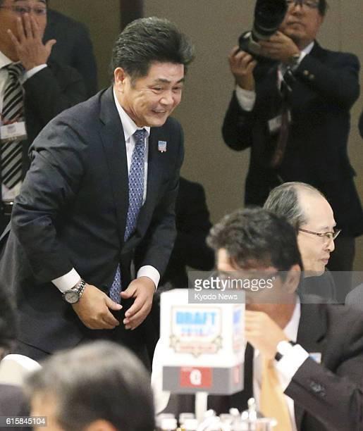 Kimiyasu Kudo manager of the Pacific League baseball club SoftBank Hawks smiles at a hotel in Tokyo on Oct 20 after his lottery win of Soka...