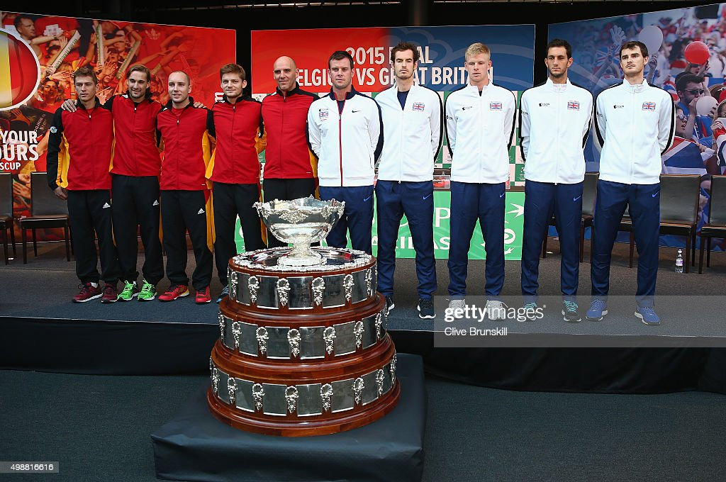 L-R Kimmer Coppejans,Ruben Bemelmans,Steve Darcis,David Goffin and team captain Johan Van Herck of Belgium,team captain Leon Smith,Andy Murray, Kyle Edmund,James Ward and Jamie Murray of Great Britain pose for a photograph with the Davis Cup trophy after the draw ceremony ahead of the start of the Davis Cup Final at Flanders Expo on November 26, 2015 in Ghent, Belgium.