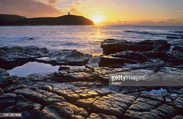 Kimmeridge Bay at sunrise Jurassic Coast World Heritage Site Marine Nature Reserve Dorset England.