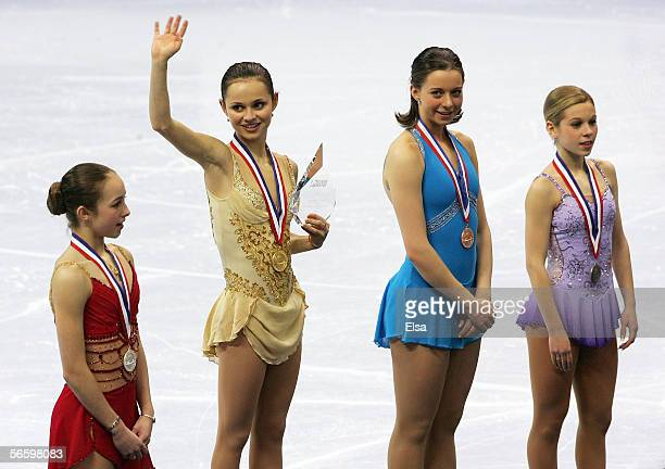 Kimmie Meissner, silver, Sasha Cohen, gold, Emily Hughes, bronze and Katy Taylor, pewter, stand on the podium after receiving their medals at the...