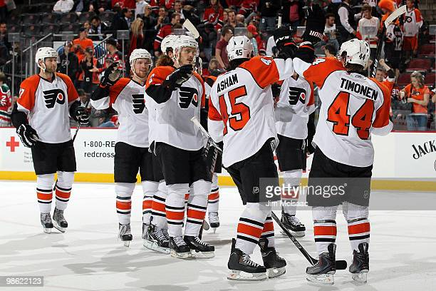 Kimmo Timonen and Arron Asham of the Philadelphia Flyers celebrate after defeating the New Jersey Devils by the score of 30 to win in Game 5 of the...