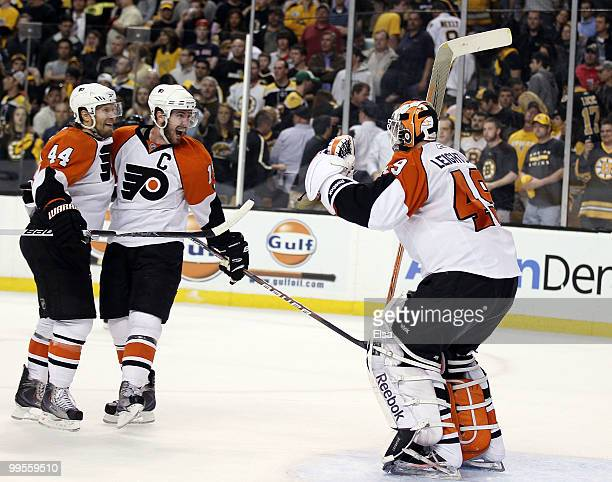 Kimmo Timonen and Mike Richards of the Philadelphia Flyers celebrates the win with goalie Michael Leighton after defeated the Boston Bruins in Game...