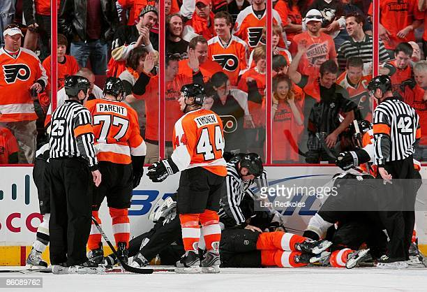 Kimmo Timonen and Ryan Parent of the Philadelphia Flyers tangle with members of the Pittsburgh Penguins as Referees Dan O' Rourke and Marc Joannette...
