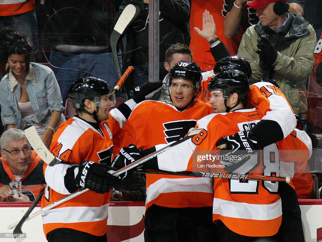 Kimmo Timonen #44, Brayden Schenn #10, Wayne Simmonds #17, and Claude Giroux #28 of the Philadelphia Flyers celebrate Simmonds' game winning power-play goal in the third period against the Winnipeg Jets on February 23, 2013 at the Wells Fargo Center in Philadelphia, Pennsylvania. The Flyers went on to defeat the Jets 5-3.