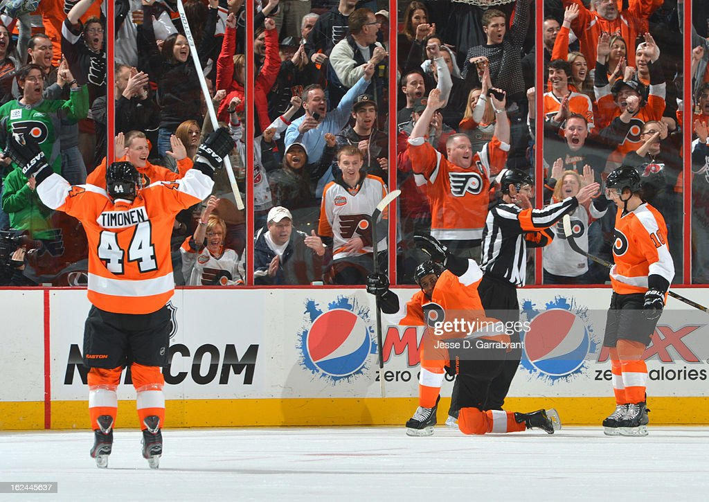 Kimmo Timonen #44 ( L) celebrates alongside Wayne Simmonds #17 ( C) and Brayden Schenn #10 ( R) of the Philadelphia Flyers during the game against the Winnipeg Jets on February 23, 2013 at the Wells Fargo Center in Philadelphia, Pennsylvania.