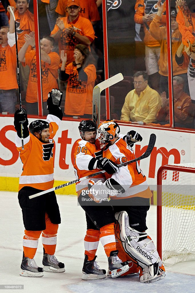 Kimmo Timonen #44, Darroll Powe #36 and Michael Leighton #49 of the Philadelphia Flyers celebrate after defeating the Montreal Canadiens by a score of 4-2 to win Game 5 of the Eastern Conference Finals and to advance to the 2010 NHL Stanley Cup Finals at Wachovia Center on May 24, 2010 in Philadelphia, Pennsylvania.