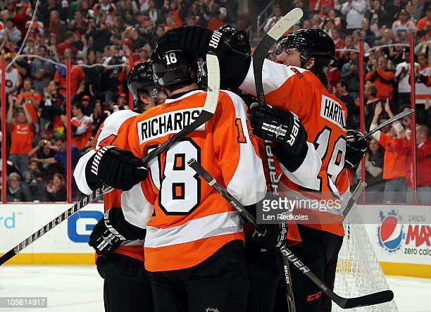 Kimmo Timonen Mike Richards and Scott Hartnell of the Philadelphia Flyers celebrate a first period power play goal by Danny Briere against the...