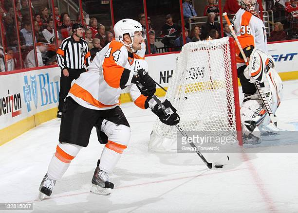 Kimmo Timonen of the Philadelphia Flyers caries the puck from behind the net during a NHL game against the Carolina Hurricanes on November 14 2011 at...