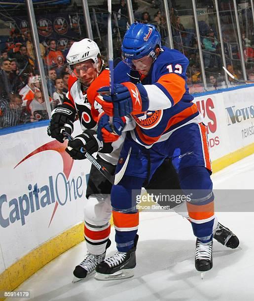 Kimmo Timonen of the Philadelphia Flyers checks Josh Bailey of the New York Islanders on April 11 2009 at the Nassau Coliseum in Uniondale New York