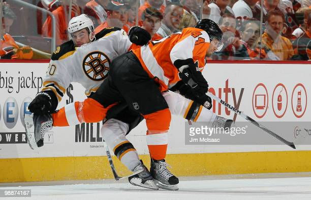 Kimmo Timonen of the Philadelphia Flyers collidesa with Daniel Paille of the Boston Bruins in Game Three of the Eastern Conference Semifinals during...