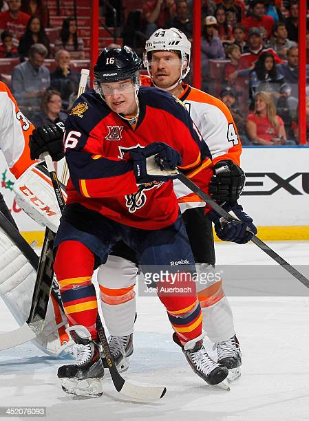 Kimmo Timonen of the Philadelphia Flyers defends against Aleksander Barkov of the Florida Panthers at the BBT Center on November 25 2013 in Sunrise...