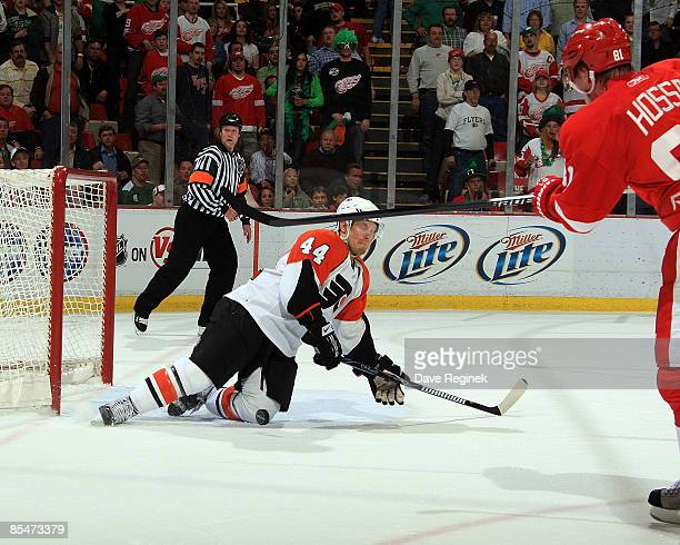 Kimmo Timonen of the Philadelphia Flyers saves a goal by blocking a Marian Hossa of the Detroit Red Wings shot with the goalie pulled during a NHL...