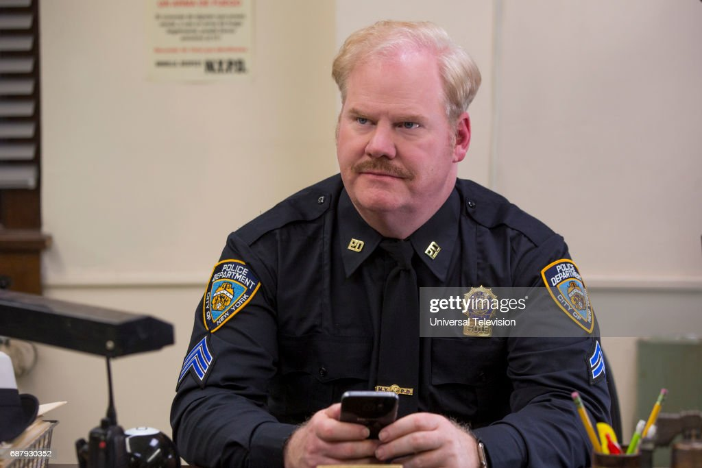 SCHMIDT -- 'Kimmy Bites an Onion!' Episode 313 -- Pictured: Jim Gaffigan as Officer Krupke --