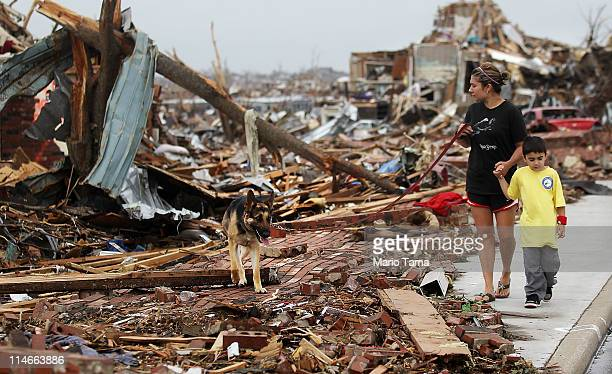Kimmy Lankford walks with her son Jack during a walk through their neighborhood after a massive tornado passed through the town killing at least 123...