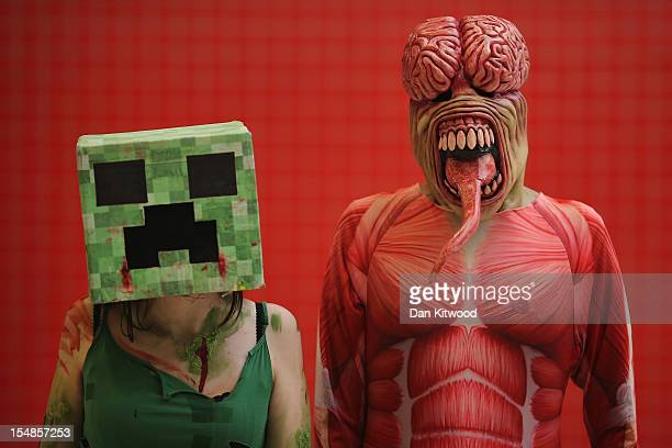 Kimmy Parris 21 from Dartford poses as a Creeper from Minecraft with friend Chris Hayne 26 from Sheffield as a Licker from Resident Evil ahead of the...