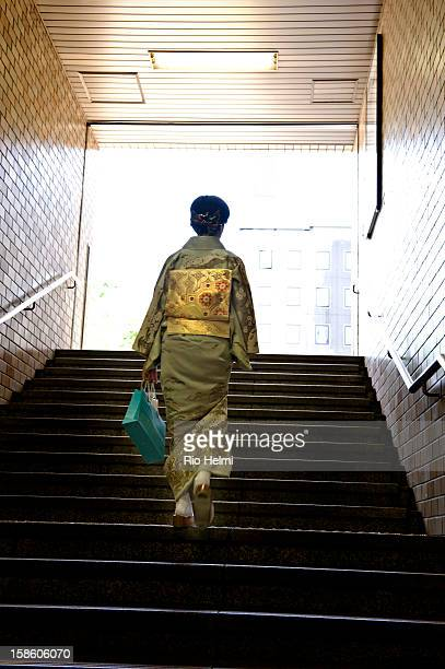 A kimono clad woman exits the subway in the Tenjin area downtown Fukuoka