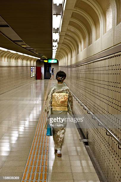 A kimono clad woman walks through to an exit from Tenjin subway station in Fukuoka