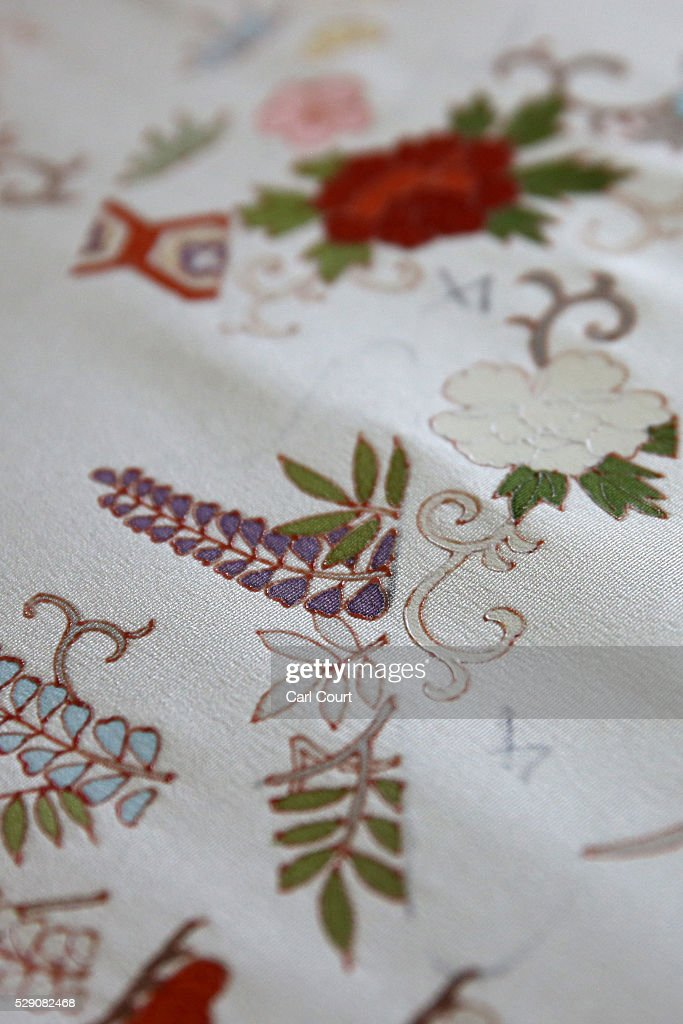 Kimono fabric is displayed after being painted during a stage of its production process at the Sensyo Ichikawa kimono workshop on April 26, 2016 in Kyoto, Japan. The workshop employs a traditional method of dyeing called Kyo-Yuzen. Unique to Kyoto it is used to dye silk fabric for kimonos by hand-painting with natural dyes made from flower petals. The technique can be divided into 26 processes and each part is handled by the master of that process.