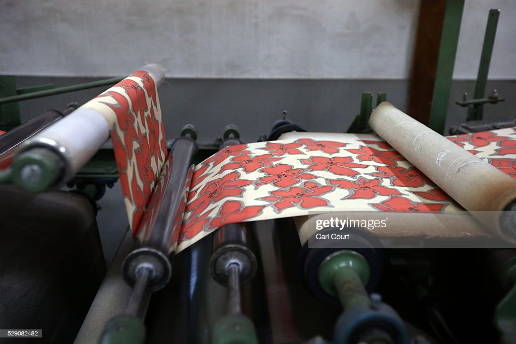 Kimono fabric is pressed flat after the painting and dyeing process where it is often creased, during a stage of its production process at the Sensyo Ichikawa kimono workshop on April 26, 2016 in Kyoto, Japan. The workshop employs a traditional method of dyeing called Kyo-Yuzen. Unique to Kyoto it is used to dye silk fabric for kimonos by hand-painting with natural dyes made from flower petals. The technique can be divided into 26 processes and each part is handled by the master of that process.