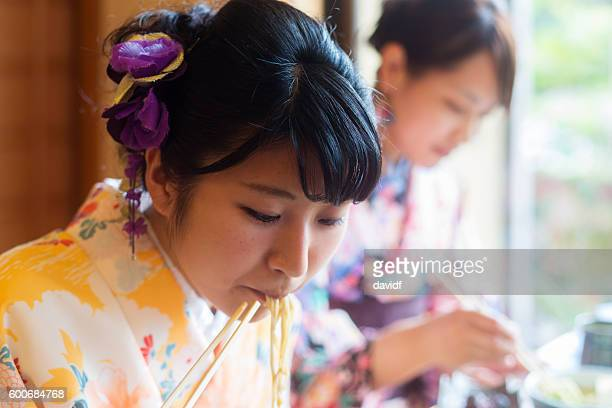 Kimono Wearing Young Japanese Women Eating Noodles in a Restaurant