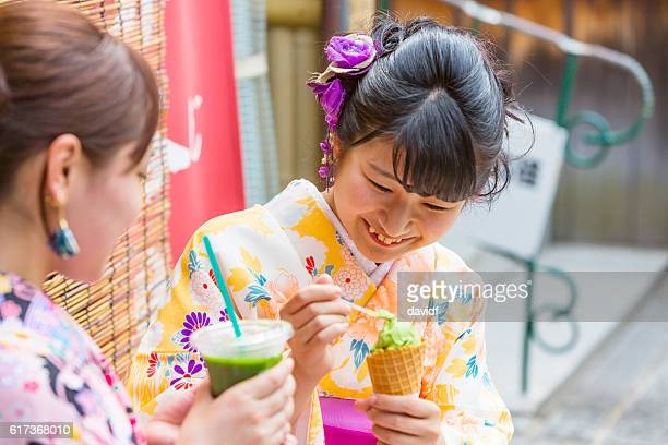 Kimono Wearing Young Japanese Women With Matcha Tea Ice Cream