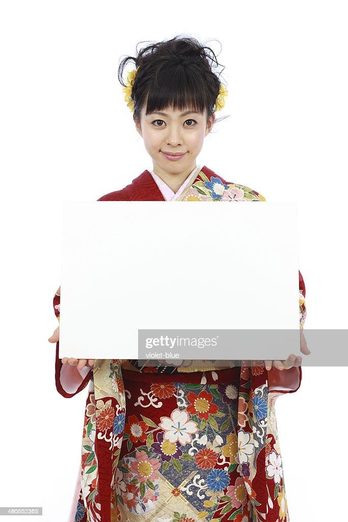 Kimono woman showing message board : Stock Photo