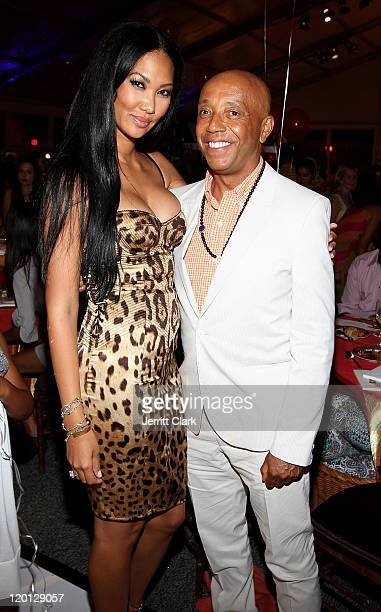 Kimora Lee and Russell Simmons attend the 12th annual Art for Life benefit at a Private Residence on July 30 2011 in East Hampton New York