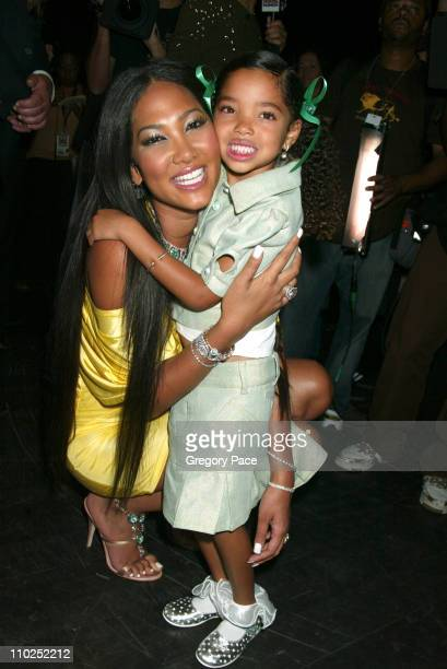 Kimora Lee Simmons and daughter Ming Lee Simmons during Olympus Fashion Week Spring 2006 Baby Phat Backstage Inside Arrivals and Front Row at Radio...