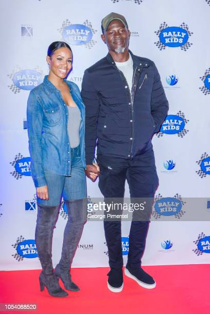 Kimora Lee Simmons and Djimon Hounsou attend the Rally For Kids Scavenger Cup In Toronto The Qualifiers Celebrity Draft Party at the Hotel X's High...