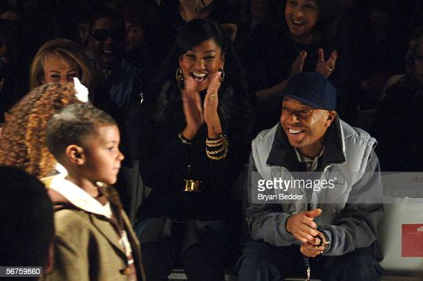 Kimora Lee Simmons and her husband music producer Russell Simmons react as their daughters Ming Lee and Aoki Lee walk the runway at the Child...