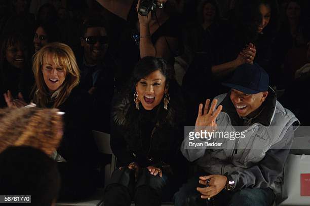 Kimora Lee Simmons and her husband music producer Russell Simmons watch their daughters Ming Lee and Aoki Lee walk the runway at the Child Magazine...