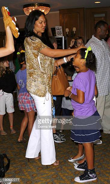 """Kimora Lee Simmons and Ming Lee Simmons visit """"Shrek The Musical"""" at the Broadway Theatre on August 15, 2009 in New York City."""