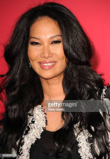 Kimora Lee Simmons arrives at the The Hunger Games Catching Fire Los Angeles Premiere at Nokia Theatre LA Live on November 18 2013 in Los Angeles...