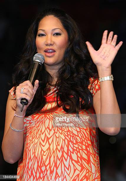 Kimora Lee Simmons refers to notes written on her hand for her speech at the Market America Leadership School at the American Airlines Arena on...