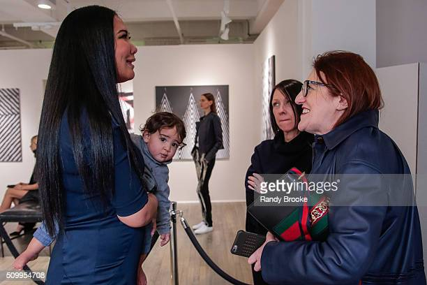 Kimora Lee Simmons with son Wolfe Lee Leissner pose with Harper's Bazaar's Glenda Bailey while attending Kimora Lee Simmons Presentation during the...