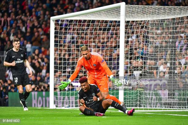 Kimpembe Presnel of PSG reacts after blocking a shot as goalkeeper Alphonse Areola of PSG looks on during the Champions League match between Real...
