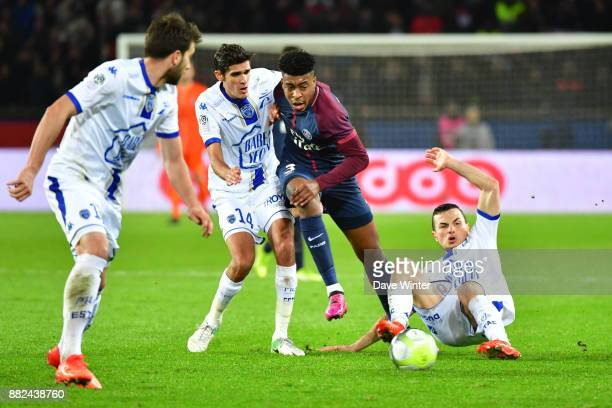Kimpembe Presnel of PSG slips between the opposition defence during the Ligue 1 match between Paris Saint Germain and Troyes Estac at Parc des...