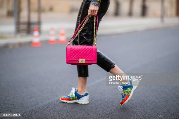 Kimyana Hachmann is seen red Chanel bag multi colored sneaker Chanel yellow Louis Vuitton hoody Valentino college jacket Ray Ban sunglasses on...