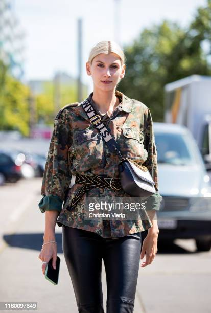 Kimyana Hachmann is seen wearing camouflage jacket, black leather pants, boots outside Marina Hoermanseder during Berlin Fashion Week on July 04,...