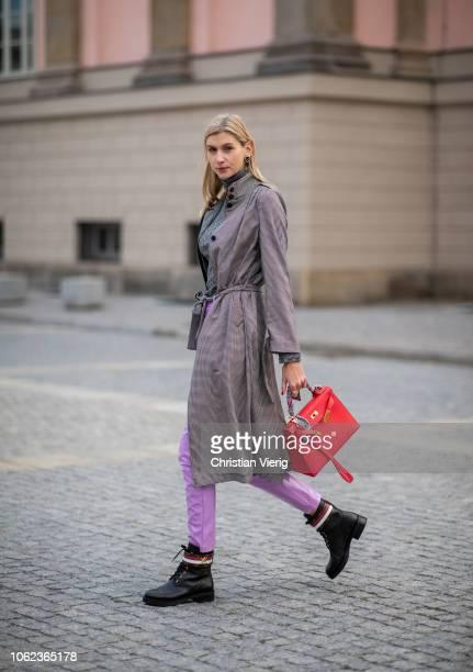 Kimyana Hachmann is seen wearing grey turtleneck grey plaid belted coat pink rose vinyl pants Louis Vuitton boots red Hermes Kelly bag on November 15...