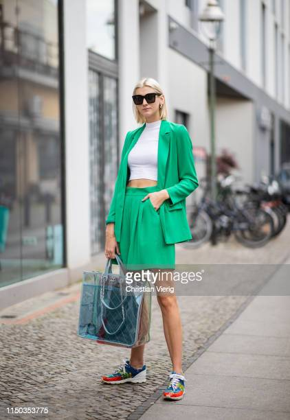 Kimyana Hachmann is seen wearing see through Chanel bag, Chanel shoes, white cropped shirt, green pleated skirt and blazer, Celine sunglasses on May...