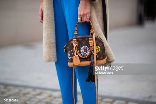 Kimyana Hachmann is seen wearing white Balmain tshirt Chloe boots Louis Vuitton bag Celine sunglasses beige teddy coat blue cropped pants on November...