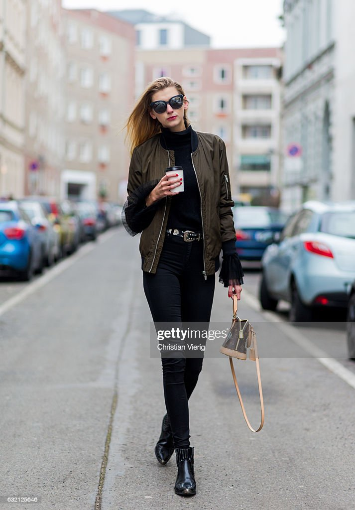 Kimyana Hachmann wearing a top and bomber jacket Zara, H&M pants, Mango ankle boots, Louis Vuitton bag, Chanel sunglasses during the Mercedes-Benz Fashion Week Berlin A/W 2017 at Kaufhaus Jandorf on January 19, 2017 in Berlin, Germany.
