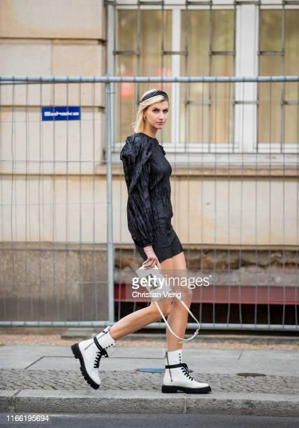 Kimyana Hachmann wearing black dress Rotate Birger Christensen, white boots is seen on August 04, 2019 in Berlin, Germany.