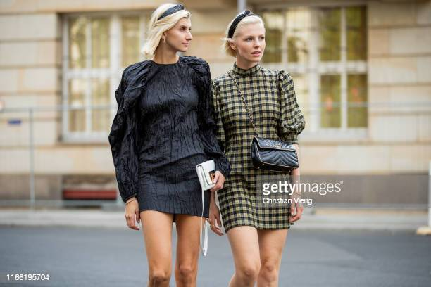 Kimyana Hachmann wearing black dress Rotate Birger Christensen, white boots Kennel und Schmenger, white Fendi bag and Carolin Laufenburger wearing...