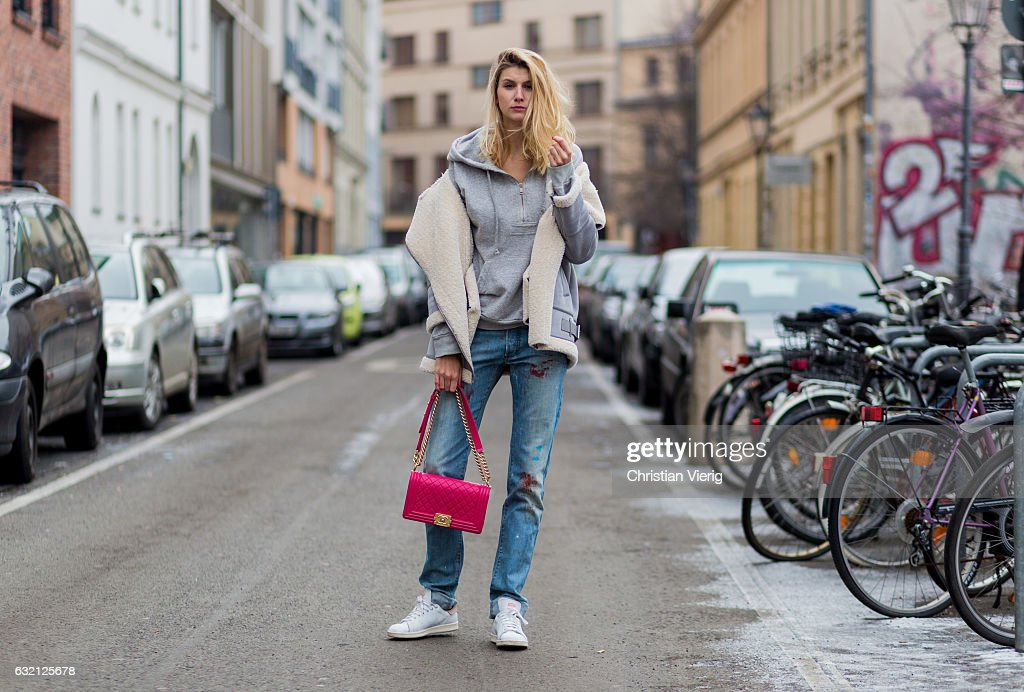 Kimyana Hachmann wearing Dior denim jeans, pink Chanel bag, Adidas Stan Smith sneaker, Zara jacket, Dolce & Gabbana hoody, during the Mercedes-Benz Fashion Week Berlin A/W 2017 at Kaufhaus Jandorf on January 19, 2017 in Berlin, Germany.