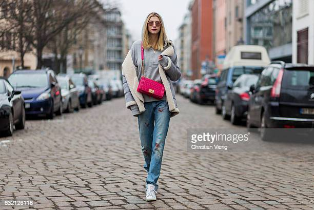 Kimyana Hachmann wearing Dior denim jeans pink Chanel bag Adidas Stan Smith sneaker Zara jacket Dolce Gabbana hoody during the MercedesBenz Fashion...
