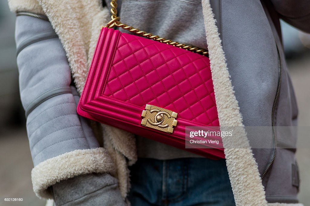 92350cb13d1516 Kimyana Hachmann wearing Dior denim jeans, pink Chanel bag, Adidas ...