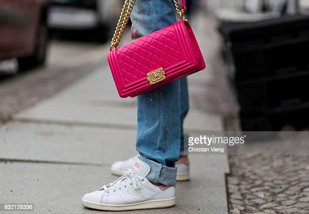 Kimyana Hachmann wearing Dior denim jeans pink Chanel bag Adidas Stan Smith sneaker Zara jacket Dolce Gabbana hoody during the MercedesBenz Fashion...