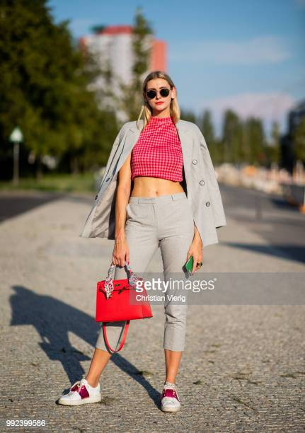 Kimyana Hachmann wearing grey cropped pants red Hermes bag grey jacket cropped top is seen outside Dawid Tomaszewski during the Berlin Fashion Week...